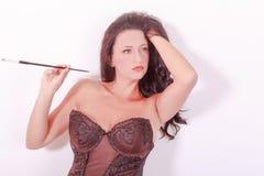 抽一名妇女的画象束腰的在 图库摄影
