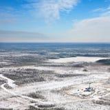抽油装置在冬天 免版税库存照片