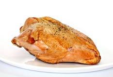 抽烟的乳房鸡 库存照片