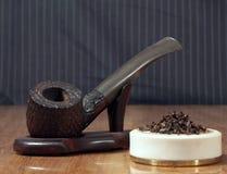 抽烟的木管道 免版税图库摄影