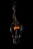 抽烟的电灯泡 图库摄影