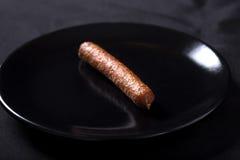 抽烟的香肠 免版税库存照片