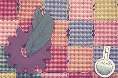 抽象与齿轮和叶子的彩虹五颜六色的纸背景 库存照片