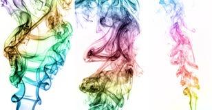 抽象五颜六色的烟拼贴画在黑背景的 免版税库存照片