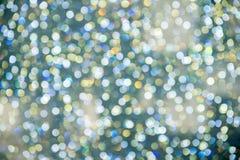 抽象五颜六色的Bokeh盘旋圣诞节背景 免版税图库摄影