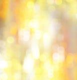 抽象假日发光的金黄背景 免版税库存照片