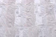 抽象做了†‹â€ ‹白色织品和欧洲金钱 库存图片