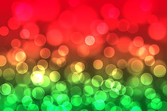 抽象光在绿色和红色背景中 免版税库存照片