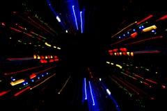 抽象光线影响在晚上,光五颜六色的条纹  免版税库存图片