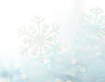 抽象冬天蓝色bokeh雪花背景 免版税库存照片