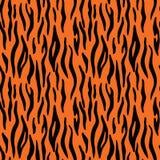 抽象动物印刷品 与老虎条纹的无缝的传染媒介样式 库存图片