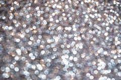抽象发光的银色闪烁闪闪发光背景 免版税图库摄影
