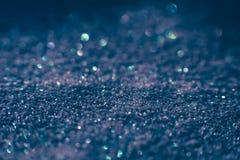 抽象发光的闪烁紫罗兰色假日背景 图库摄影