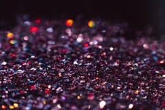 抽象发光的闪烁紫罗兰色假日背景 免版税图库摄影