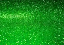 抽象发光的绿色闪烁背景 库存照片