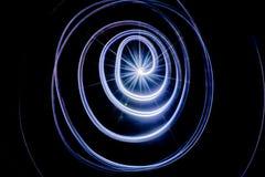 抽象图片光足迹,在黑背景的螺旋 图库摄影