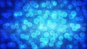 抽象在发光蓝色梯度背景的光Bokeh和闪闪发光 库存照片