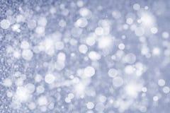 抽象在银的圣诞节闪烁的背景 库存照片