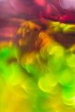 抽象在锡纸的背景流动的颜色 免版税库存照片