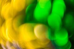 抽象在锡纸的背景流动的颜色 库存图片