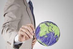 画抽象地球的商人手 免版税库存图片