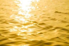 抽象太阳反射性表面金子 免版税库存图片