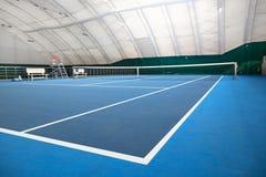 抽象室内网球场 库存照片