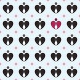 抽象小点和小滴,创造心脏、黑色和红色 海 免版税库存照片