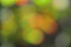 抽象心情背景在布朗绿金和桔子 库存图片