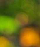 抽象心情背景在布朗绿金和桔子 免版税库存照片