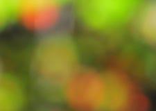 抽象心情背景在布朗绿金和桔子 图库摄影
