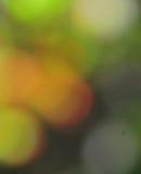 抽象心情背景在布朗绿金和桔子 库存照片