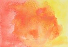抽象手拉的橙色和红色水彩 免版税库存照片