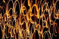 抽象明亮的多彩多姿的发光的线和曲线 免版税库存图片