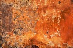 抽象明亮的橙红纹理 难看的东西背景-设计师幻想的空的空间 老墙壁 免版税库存图片