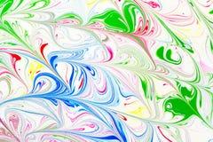 抽象样式,传统Ebru艺术 颜色与波浪的墨水油漆 背景细部图花卉向量 库存图片
