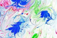 抽象样式,传统Ebru艺术 颜色与波浪的墨水油漆 背景细部图花卉向量 免版税图库摄影