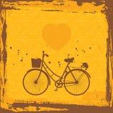 抽象框架grunge 在橙色背景模板的自行车剪影 向量 免版税库存照片