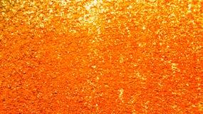 抽象桔子和金子闪烁纹理背景 库存照片