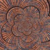 抽象棕色红色花形状螺旋砖墙样式背景纹理 布朗难看的东西砖墙圆的螺旋样式分数维 库存照片