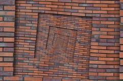 抽象棕色红色螺旋砖墙样式背景纹理 布朗难看的东西砖墙螺旋样式分数维背景砖w 库存照片