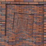 抽象棕色红色螺旋砖墙样式背景纹理 布朗难看的东西砖墙螺旋样式分数维背景砖w 库存图片