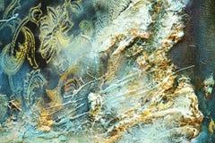 抽象油漆闪耀的金有机纺织品安眠药背景 库存照片