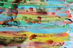 抽象泥泞的蜡状的背景 嬉戏的形式,蜡,油漆,水彩颜色 免版税库存照片