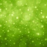 抽象浅绿色的bokeh星 免版税库存图片