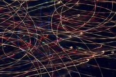抽象灯光管制线在黑背景中 库存照片
