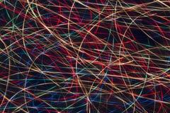 抽象灯光管制线在黑背景中 免版税库存照片