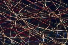 抽象灯光管制线在黑背景中 库存图片