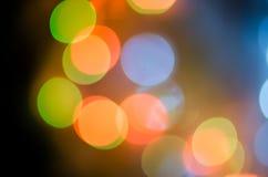 抽象空白背景圣诞节黑暗的装饰设计模式红色的星形 与bokeh defocused光的欢乐抽象背景 免版税图库摄影