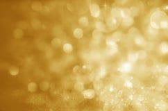 抽象空白背景圣诞节黑暗的装饰设计模式红色的星形 Defocused金黄假日摘要的闪烁 库存图片